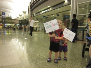 Waiting for their Uncle to get off the plane after serving a two-year LDS mission in Mexico.